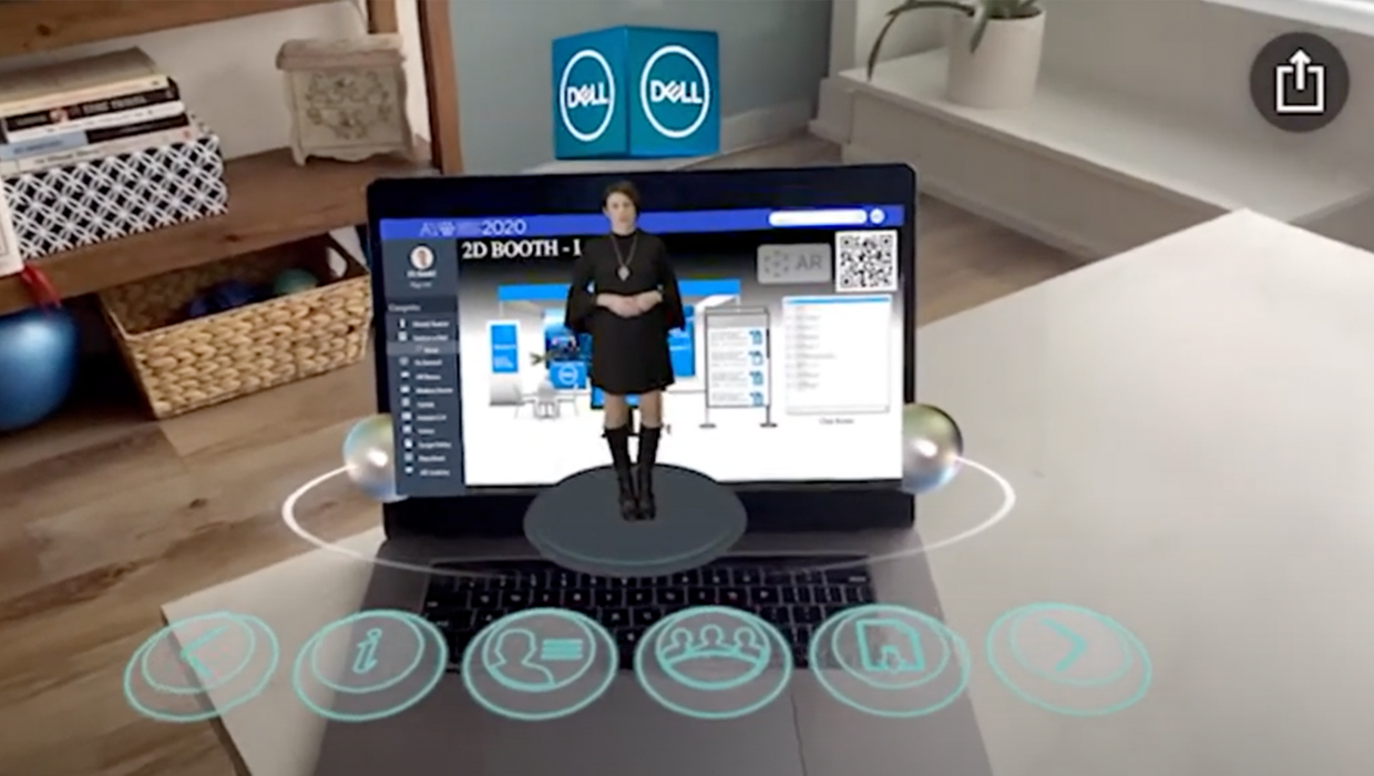 Augmented Reality hologram coming out of computer